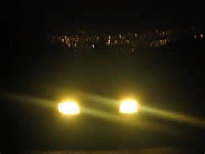 Yellow Headlamps at Night