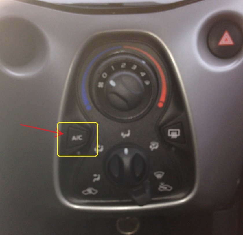 Sorry about the lousy quality. The red arrow points at the button. The yellow box shows how big the button ought to be. Notice all the unemployed space around the panel.