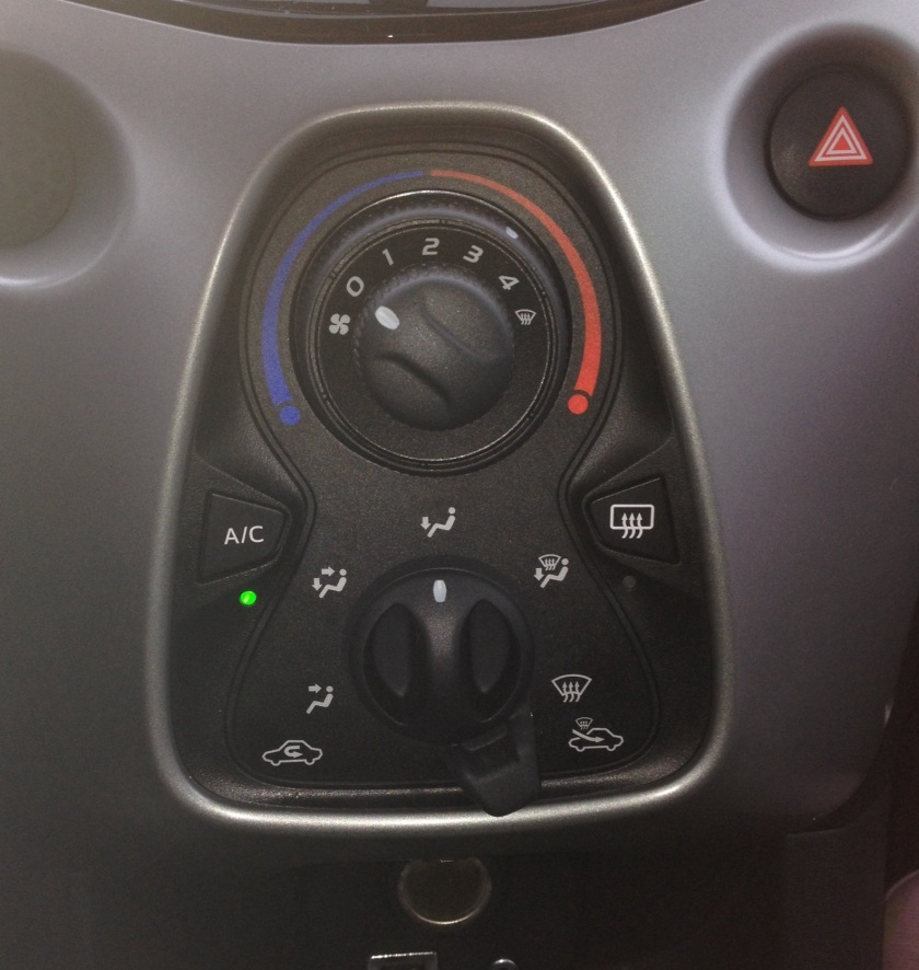 At night the green A/C light is far more prominent than the button itself. One therefore attempts to press the light not the button. Cue an opportunity for the lawyers.