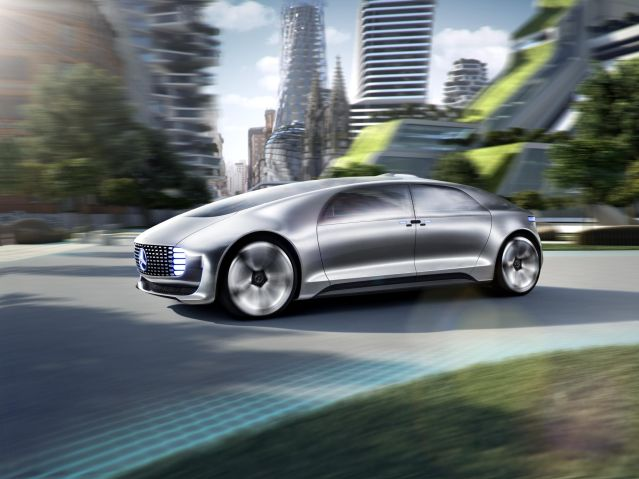 2015 Mercedes Benz customerless car concept. Note the horrible melange of anti-urban architecture in the background. Let´s get out of here.