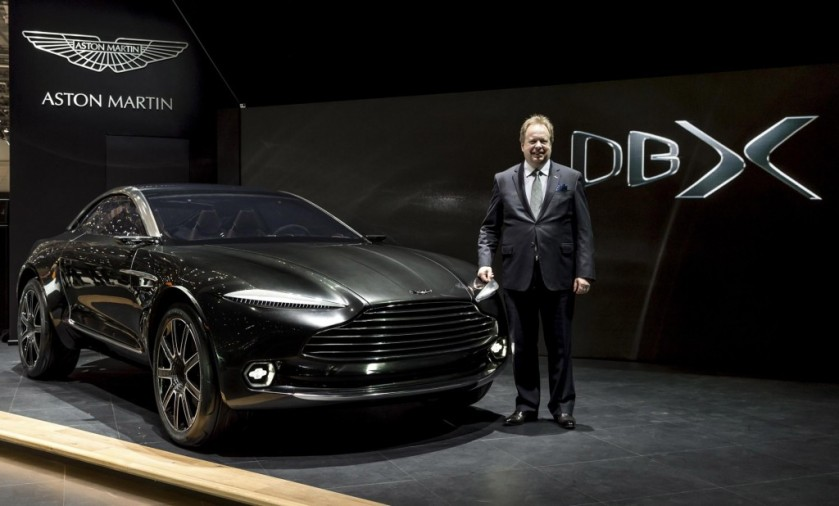 Aston Martin CEO Andy Palmer next to the DBX concept-Geneva 2015 - image via motorauthority