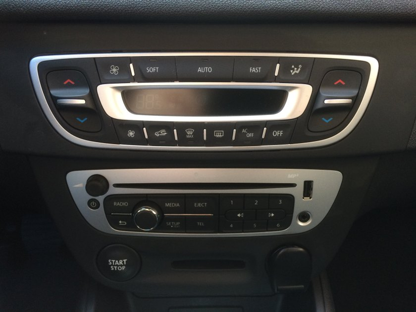 2015 Renault Megane Sports Tourer, centre console. Notice the two buttons left on the HVAC console. Those control fan speed. On the lower panel try finding the on/off switch. In the dark, driving. See: Fitt´s Law for why this is truly inexcusable.