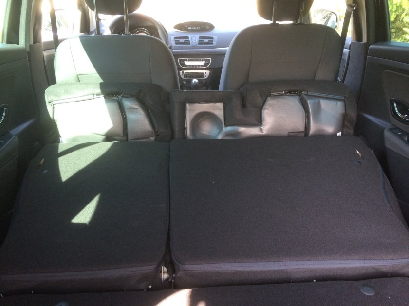 An unknown number of litres with the seats down. The seat cushions are foam pads covered in cloth. I don´think they will last but Renaults never go more than 7 years anyway. The seats don´t fold flat and the whole arrangement looks messy. Not so good. Not important but still...