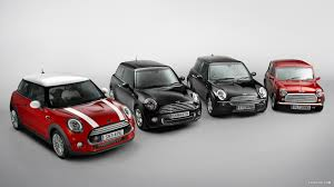 4 generations of Mini/ MINI