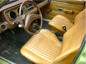 All the bells, no whistles and no rear arm-rest but the vinyl is almost bullet proof.