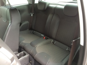 2015 Opel Adam rear passenger compartment. Room for two only. Room for their drinks as well.
