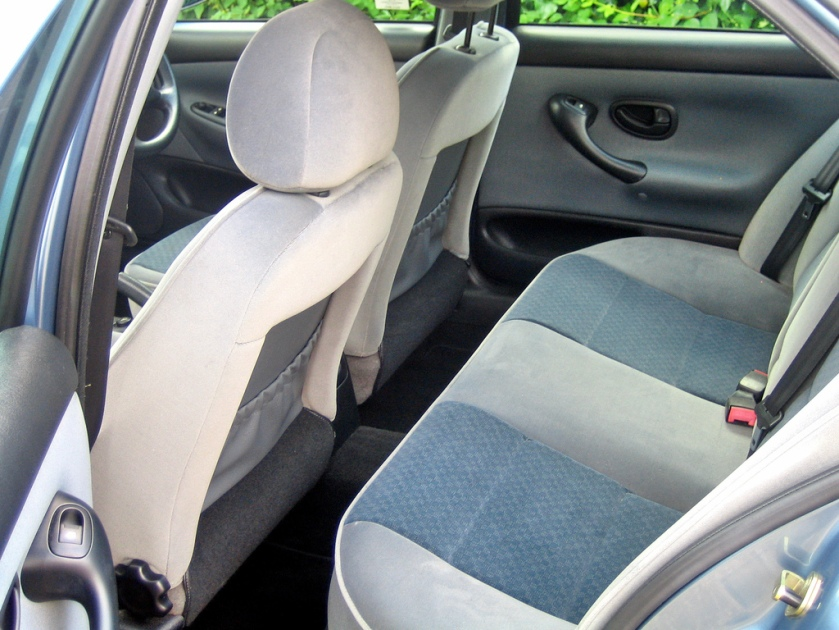 1996 Peugeot 406 interior. This photo seems to show the front seats set as far back as they can go: photo by wwarby at flickr.com