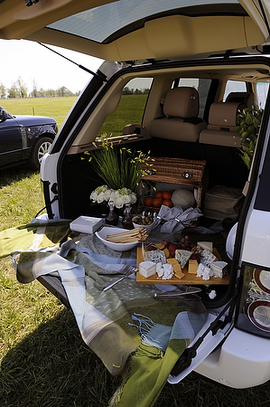 Land Rover, the vehicle sponsor for the Rolex Kentucky Three Day Event and the U.S. Equestrian Foundation, rented a set of six tailgating spots, which were outfitted with chairs, sun unbrellas and gourmet food arranged in the back of six Range Rover and Land Rover vehicles. The company was using the space as hospitality for Land Rover owners and customers Saturday. Photo by Tom Eblen | teblen@herald-leader.com