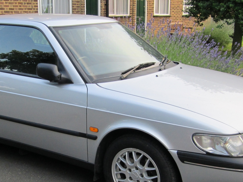 This is how Saab did it. Note the crease in the door panel which continues the wing line.