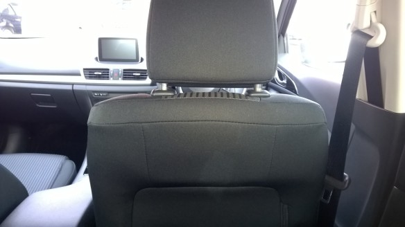 View from the rear-seat of the Mazda3 - dark and de-contented.