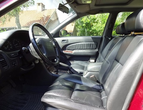 1995 Nissan Maxima QX interior. Lovely door. What a selling point.