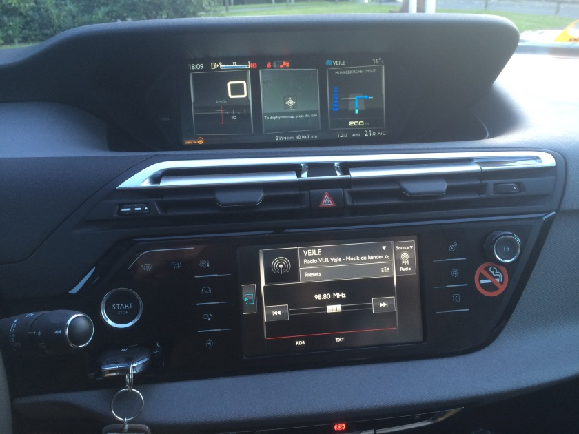 The centre console and display units of the Citroen C4 Picasso. Glare is a problem. Note the way they key fob is loctated.