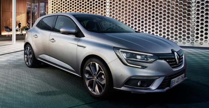 2016 Renault Megane in a cod-urban setting. Or is it suburban? Or a car-park with a cafe attached? What are we looking at here? Image: Renault Press