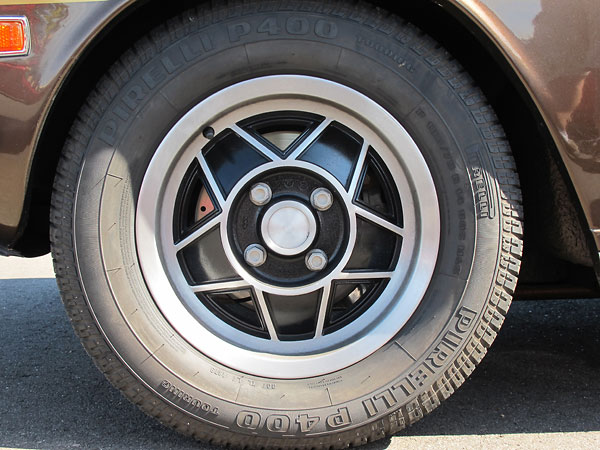 The alloy wheels fitted to later Triumph Stag models were also produced by GKN Kent. Image via British V8.org