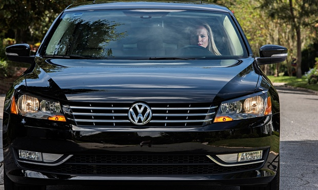 Ashley Scarpa at the wheel of her well-used 2014 VW Passat yesterday. Image vis The Guardian