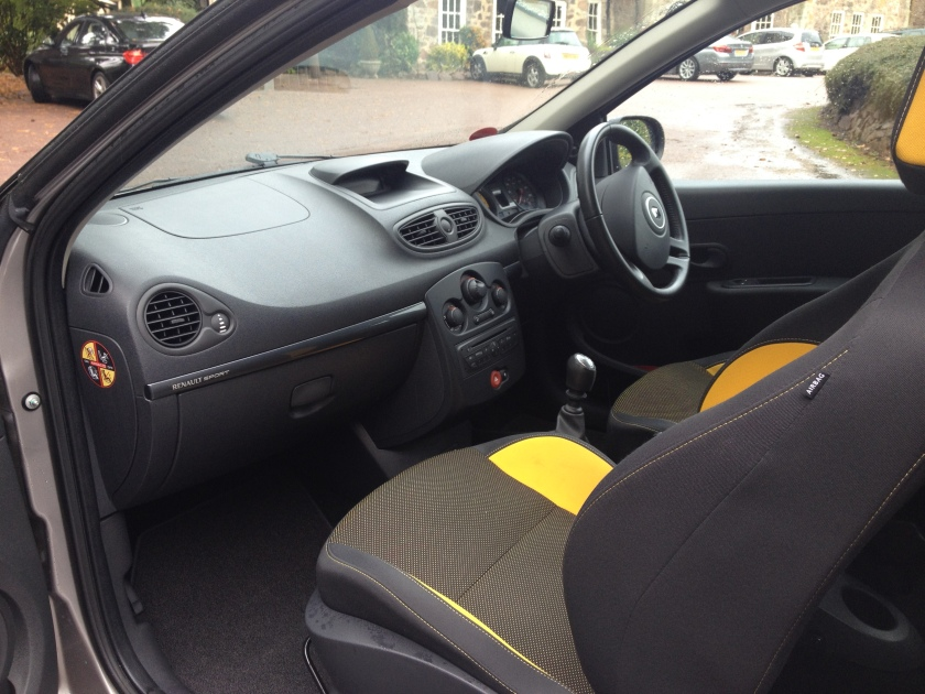 The poverty spec Cup interior is enlivened by yellow fabric inserts.