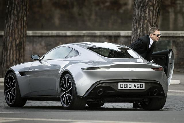 Daniel Craig as James Bond emerges from his Aston Martin DB10: thesupercarkids.com