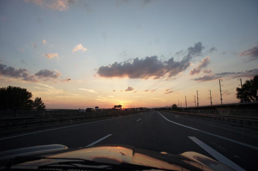 Gratuitois 'driving towards sunset' shot.