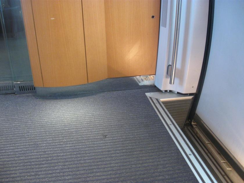 Walls meet floor in the vestibule.