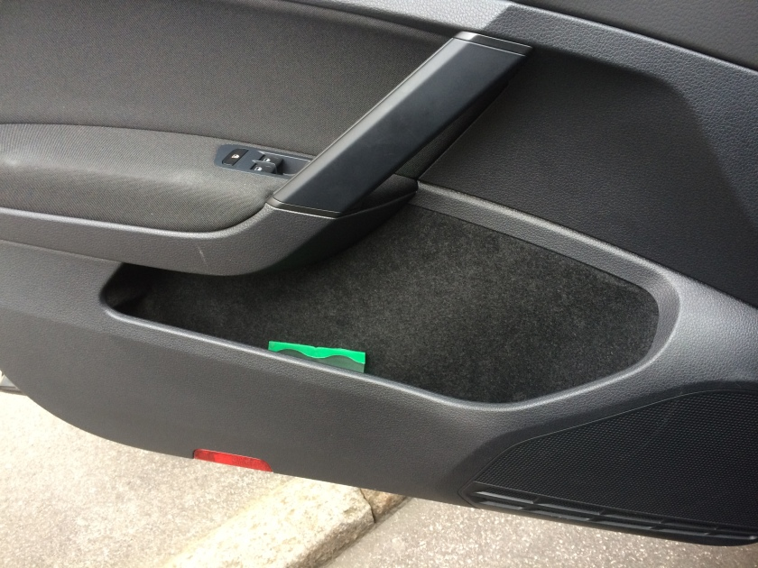 2016 VW Golf driver's door bin. Comfy for 'phones.