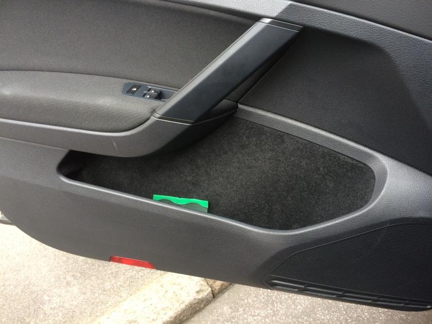 2016 VW Golf driver's door bin. Comfy for 'phones.