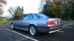 Rear three quarters silver BMW 7 series E38