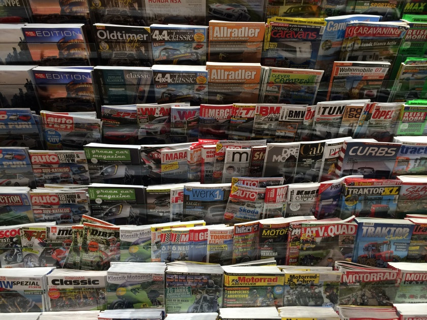 Lots of magazines in a German railway station.