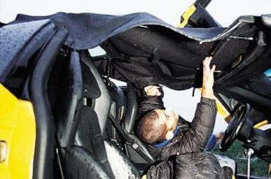 Erecting Murcielago roof - image : autocar.com