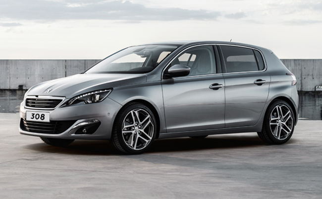 Peugeot 308 in advertiser's typical sterile backdrop.